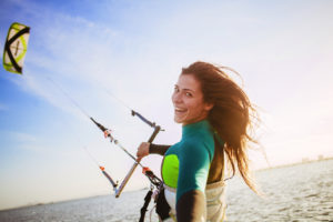 Woman kitesurfing in Murcia