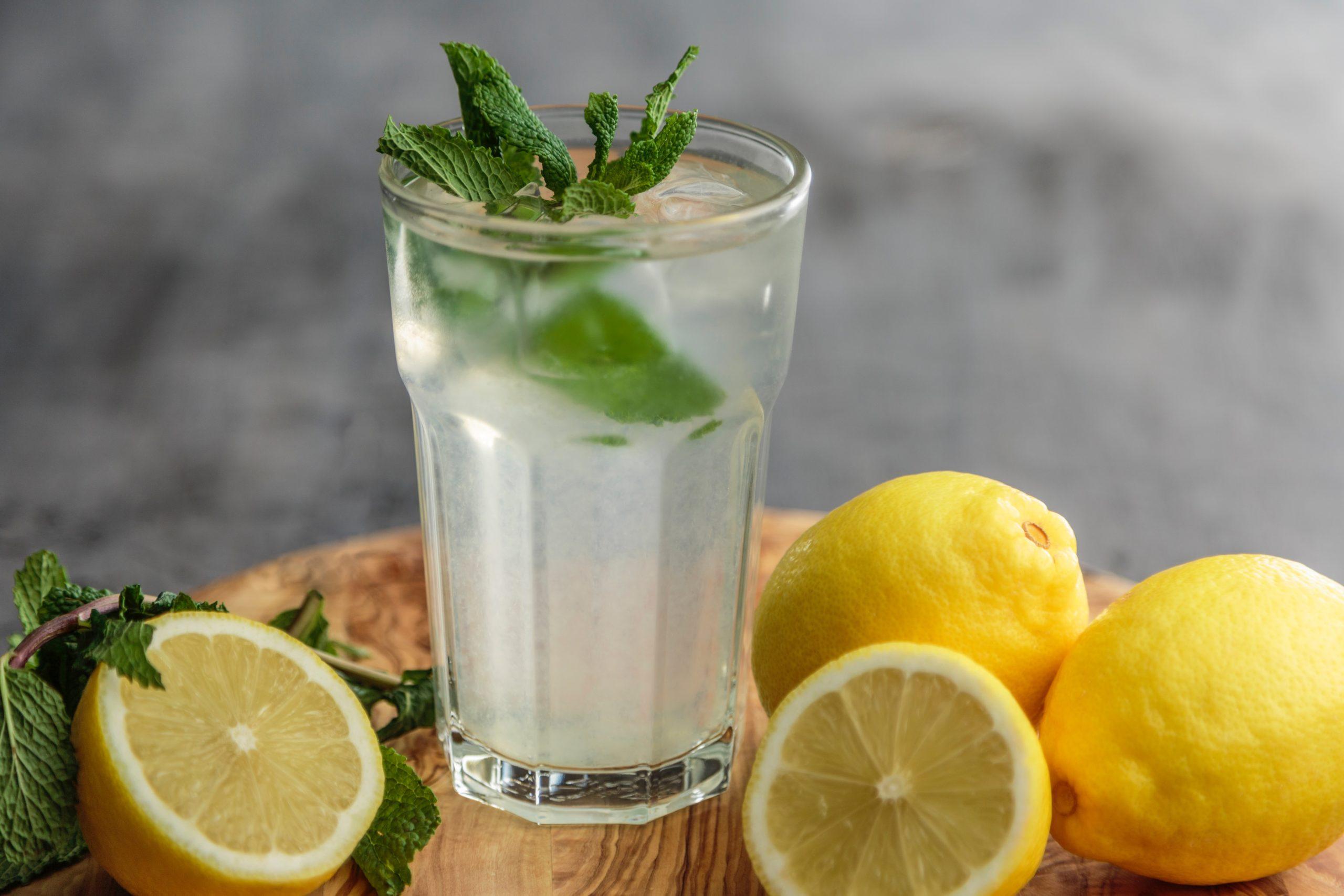 Lemons and glass of lemonade