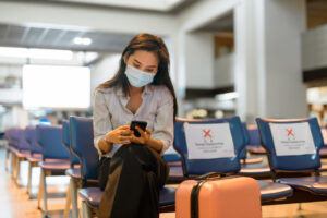 Masked passenger in airport